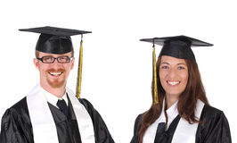 Two successful student in graduation gowns Stock Image