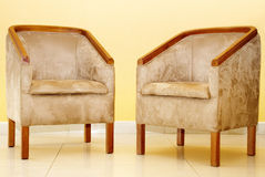 Two Suede Chairs on Tiled Floor Royalty Free Stock Images