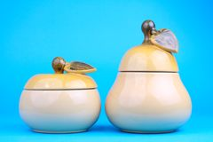 Two sugar-bowls in the form of a pear and apple Stock Photo