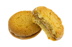 Two sugar cookies with hazelnut filling one bitten Royalty Free Stock Image