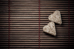 Two sugar hearts on wooden texture Royalty Free Stock Image