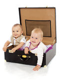 Two in a suitcase Royalty Free Stock Image