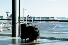 Two suitcases in airport Royalty Free Stock Photos
