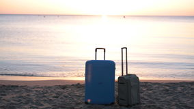 Two suitcases on the beach stock video