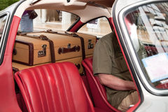Two Suitcases In The Car. Classic Car with Two Suitcases Royalty Free Stock Photos