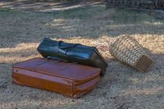 Two suitcases on the grass. Two old suitcases on the grass close-up Royalty Free Stock Photography