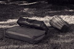Two suitcases on the grass. Two old suitcases on the grass close-up Royalty Free Stock Image