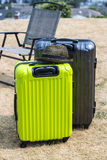 Two suitcases on the lawn Stock Photos