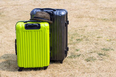 Two suitcases on the lawn Royalty Free Stock Photo