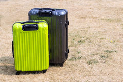 Two suitcases on the lawn Stock Images