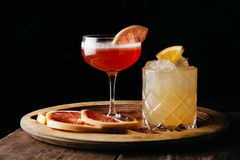 Two summer cocktails on dark background. Two summer alcoholic drinks on dark rustic background stock photo