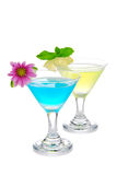 Two Summer martini cocktails blue and yellow Stock Photography