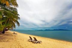 Two sun beach chairs Stock Photos