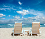 Two sun beach chairs on beach Royalty Free Stock Photos