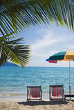 Two sun chairs at a tropical beach in Thailand Royalty Free Stock Photos