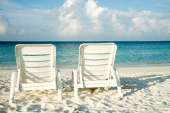 Two sun loungers on the beach Royalty Free Stock Photos