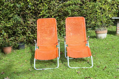 Two sun loungers in the garden Royalty Free Stock Image