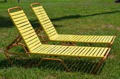 Two sun loungers in the grass Stock Photography