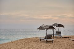 Two sun loungers. Midigama Beach. Sunset in the Indian ocean. Midigama, Sri Lanka.  royalty free stock photo