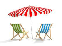 Two sun loungers and parasols Royalty Free Stock Photos