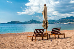 two sun loungers and parasols Royalty Free Stock Images