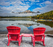 Two sun loungers are on the Piramid Lake Royalty Free Stock Photo