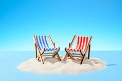 Two sun loungers on a sandy island, copy space. F royalty free stock photos