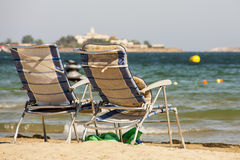 Two sun loungers by the sea. On sand stock photos