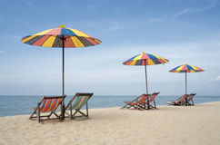 Two sun loungers and an umbrella on a beach Royalty Free Stock Photos
