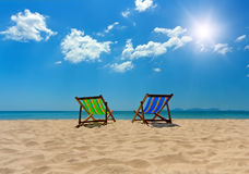 Two sunbads by the sea stock photo