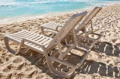 Two sunbathing chairs on the beach Stock Photography