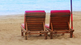 Two sunbed on beach stock footage