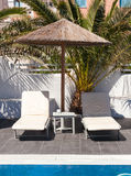 Two sunbed in a luxury hotel in Santorini island Stock Photography