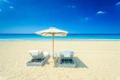 Two sunbed and one umbrella on the beach Royalty Free Stock Image
