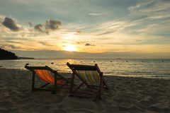 Two sunbed. Sunbeds are on the beach in evening Stock Images