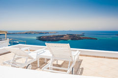 Two sunbed on the terrace. White architecture on Santorini island, Greece. Beautiful view on the sea Stock Image