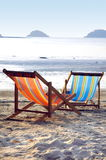 Two sunbeds on the beach in the evening sun Stock Photo