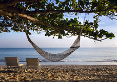 Two sunbeds and hammock Royalty Free Stock Photos