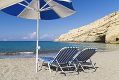 Two sunbeds and a parasol Royalty Free Stock Images