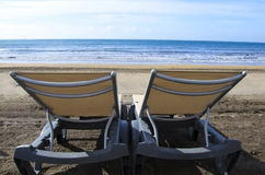 Two sunbeds on seacoast royalty free stock photography