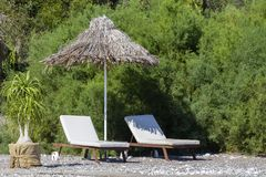 Two sunbeds and umbrella on the beach, close up. Turkey Royalty Free Stock Photos
