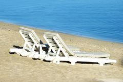 Two sundecks on the beach, facing the sea Stock Images