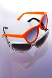 Two sunglasses. Two color sunglasses. Macro shot. Reflection background Stock Photo