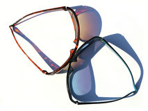 Two sunglasses with colorful shadows Royalty Free Stock Photography