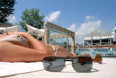 Two sunglasses near the swimming pool Stock Photography