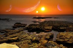 Two suns sunrise. The sunrise on a planet in a double star system, with several other planets around Royalty Free Stock Image