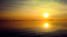 Two suns. Sunset on the lake Stock Images