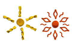 Two suns. Yellow and orange sun of plasticine Stock Photos