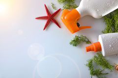 Two sunscreen spray with starfish on glass table top Stock Photography