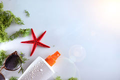 Two sunscreen spray with starfish and sunglasses top Stock Image